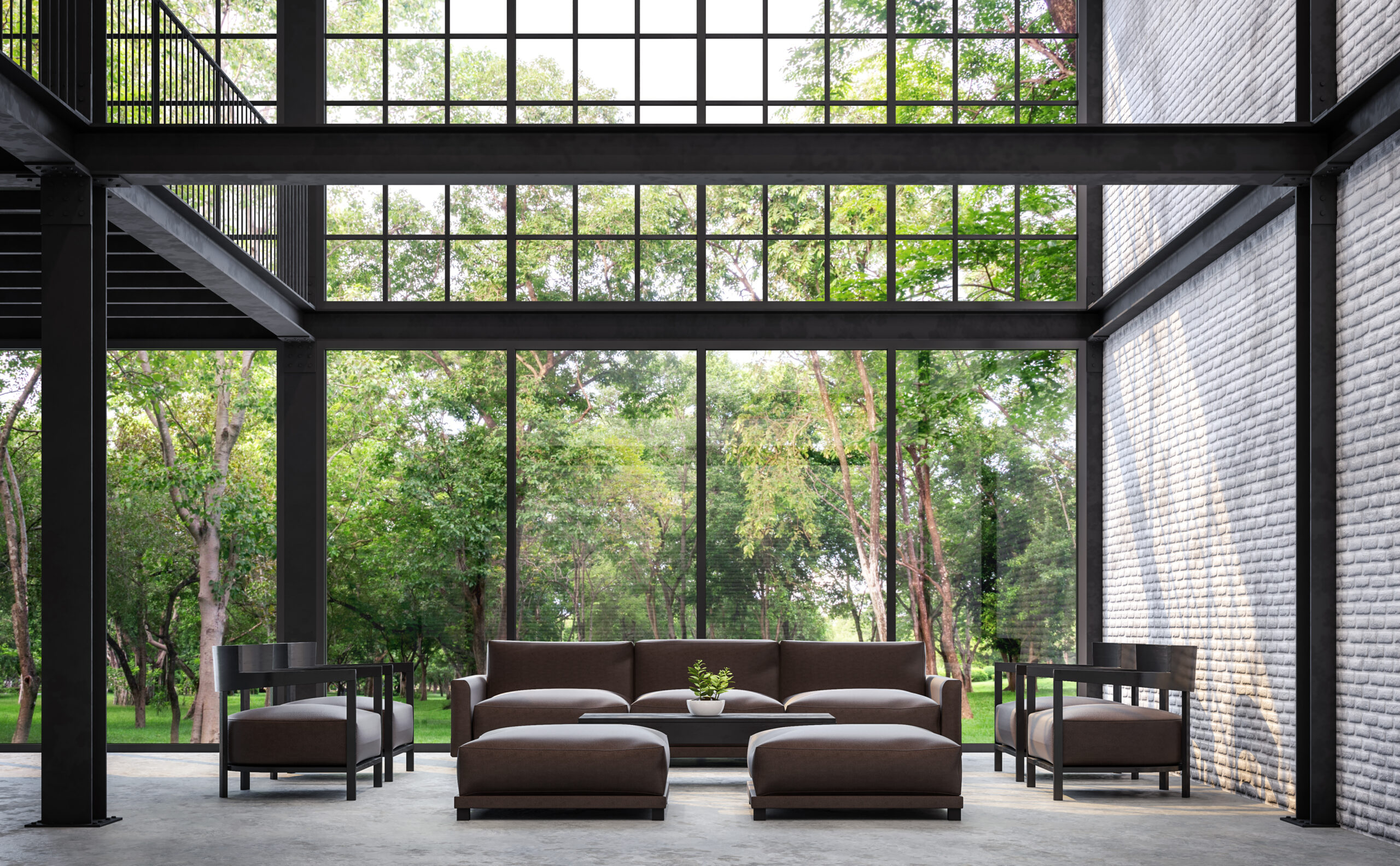Loft style living room with nature view 3d rendering image.There are white brick wall,polished concrete floor and black steel structure.Furnished with dark brown leather sofa.