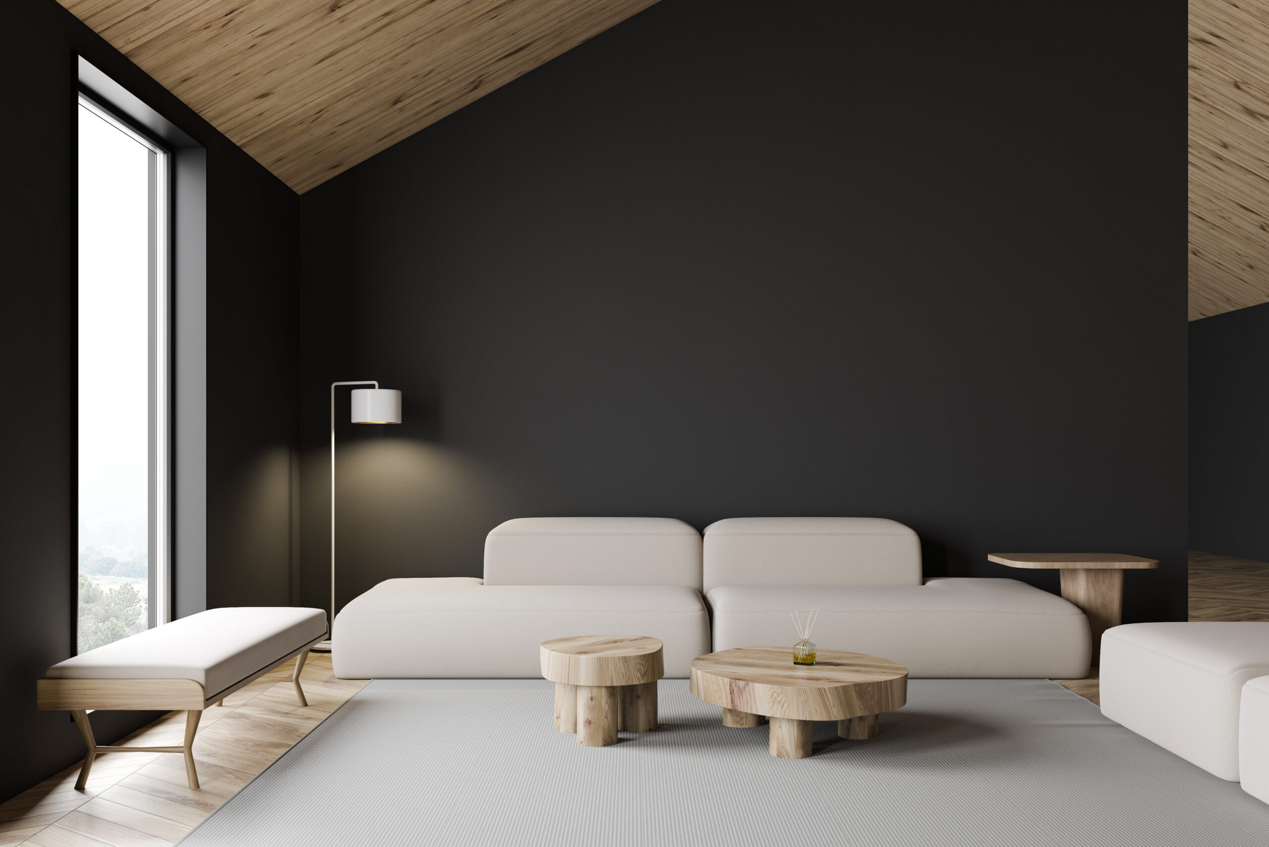 Interior of stylish attic living room with gray walls, wooden floor, comfortable white sofa and bench standing near crude round tables. 3d rendering